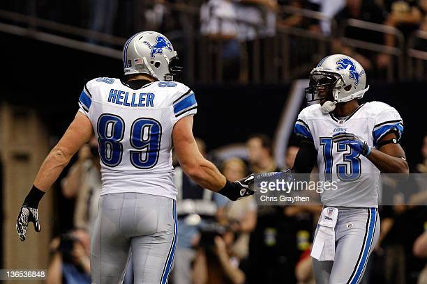 Will Heller of the Detroit Lions celebrates with teammate Nate Burleson after scoring a touchdown in the first quarter against the New Orleans Saints...