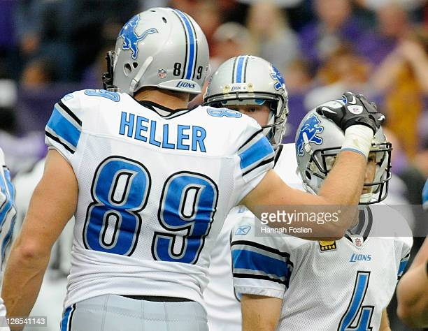 Will Heller of the Detroit Lions congratulates Jason Hanson on a field goal in the third quarter against the Minnesota Vikings on September 25 2011...