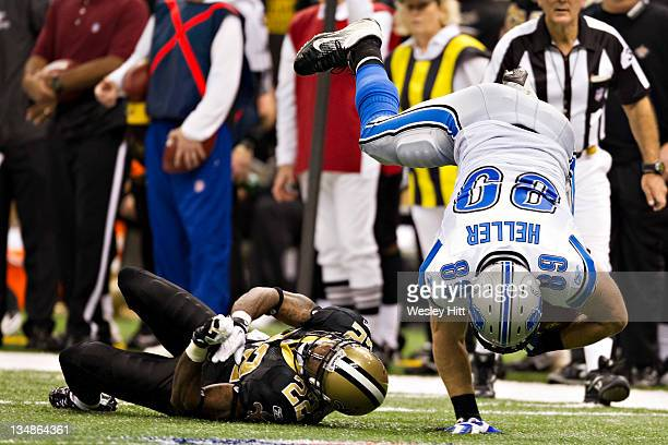 Will Heller of the Detroit Lions is tripped up by Tracy Porter of the New Orleans Saints at MercedesBenz Superdome on December 4 2011 in New Orleans...