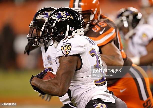 Will Hill of the Baltimore Ravens returns a blocked field goal for a touchdown during the fourth quarter against the Cleveland Browns at FirstEnergy...