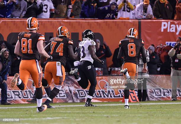 Will Hill of the Baltimore Ravens returns a blocked field goal for a touchdown in front of Jim Dray Cameron Erving and Andy Lee of the Cleveland...