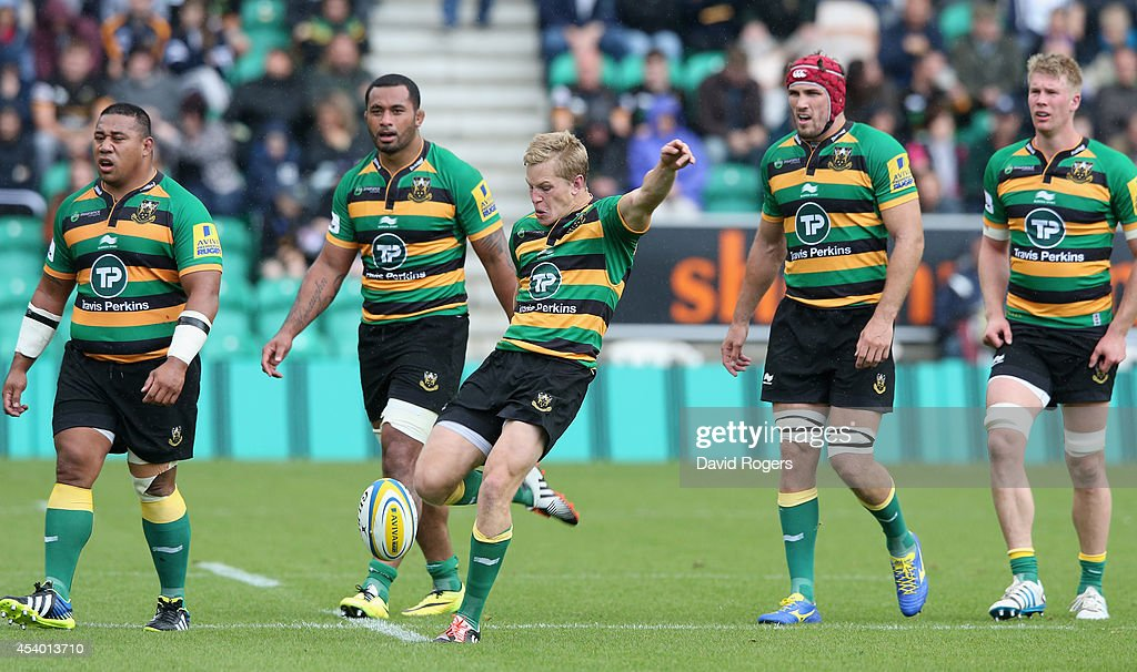 Will Hooley, of Northampton kicks the ball upfield during the pre season friendly match between Northampton Saints and Leinster at Franklin's Gardens on August 23, 2014 in Northampton, England.