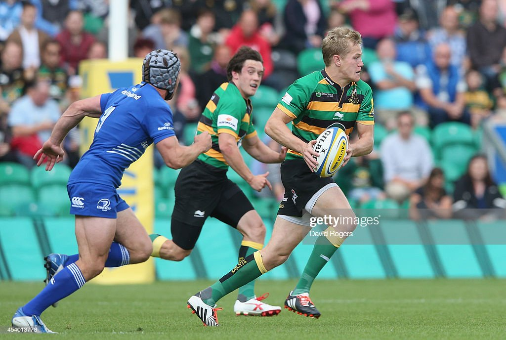 Will Hooley, of Northampton runs with the ball during the pre season friendly match between Northampton Saints and Leinster at Franklin's Gardens on August 23, 2014 in Northampton, England.