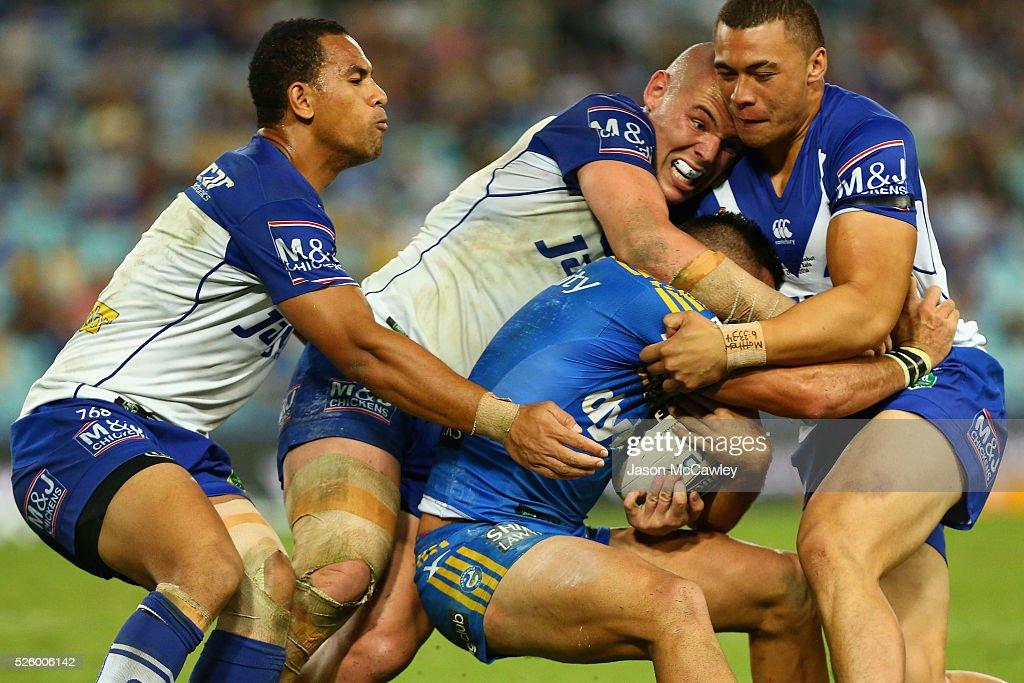 Will Hopoate, David Klemmer and Raymond Faitala-Mariner of the Bulldogs tackle of the Bulldogs during the round nine NRL match between the Parramatta Eels and the Canterbury Bulldogs at ANZ Stadium on April 29, 2016 in Sydney, Australia.