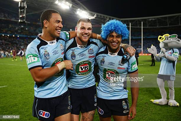 Will Hopoate Josh Dugan and Michael Jennings of the Blues celebrate the series victory at the end of game two of the State of Origin series between...