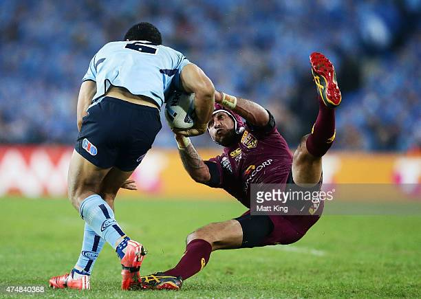 Will Hopoate of the Blues is tackled by Johnathan Thurston of the Maroons during game one of the State of Origin series between the New South Wales...