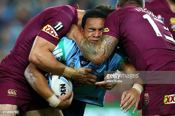 Will Hopoate of the Blues is tackled during game one of the State of Origin series between the New South Wales Blues and the Queensland Maroons at...