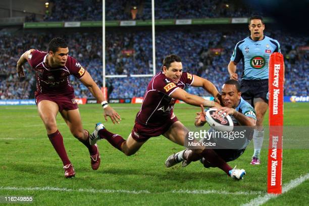 Will Hopoate of the Blues scores a try during game two of the ARL State of Origin series between the New South Wales Blues and the Queensland Maroons...