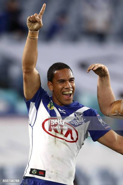 Will Hopoate of the Bulldogs celebrates Brett Morris scoring a try during the round 24 NRL match between the Canterbury Bulldogs and the Manly Sea...