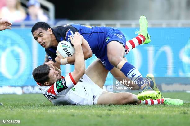 Will Hopoate of the Bulldogs is tackled by Gareth Widdop of the Dragons during the round 26 NRL match between the St George Illawarra Dragons and the...