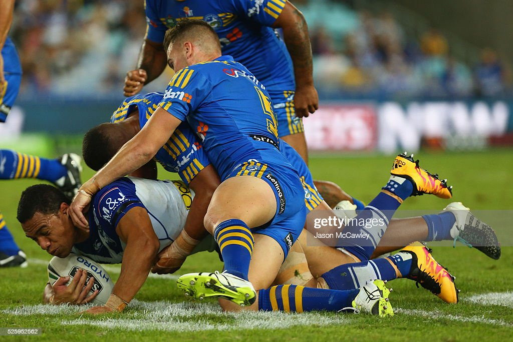 <a gi-track='captionPersonalityLinkClicked' href=/galleries/search?phrase=Will+Hopoate&family=editorial&specificpeople=6735149 ng-click='$event.stopPropagation()'>Will Hopoate</a> of the Bulldogs is tackled during the round nine NRL match between the Parramatta Eels and the Canterbury Bulldogs at ANZ Stadium on April 29, 2016 in Sydney, Australia.