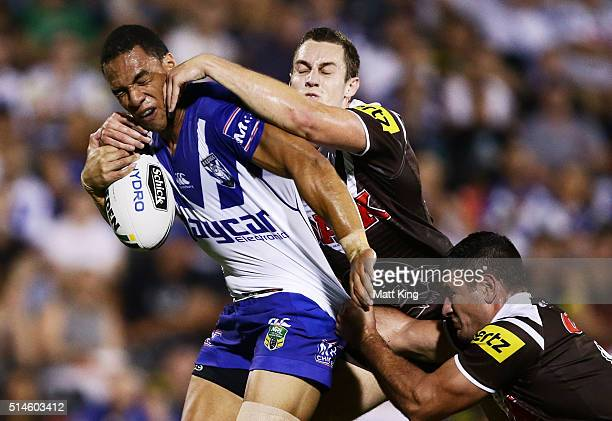 Will Hopoate of the Bulldogs is tackled during the round two NRL match between the Penrith Panthers and the Canterbury Bulldogs at Pepper Stadium on...
