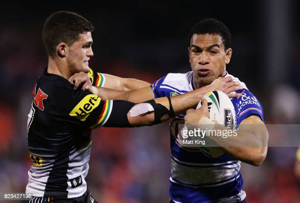 Will Hopoate of the Bulldogs puts a fend on Nathan Cleary of the Panthers during the round 21 NRL match between the Penrith Panthers and the...