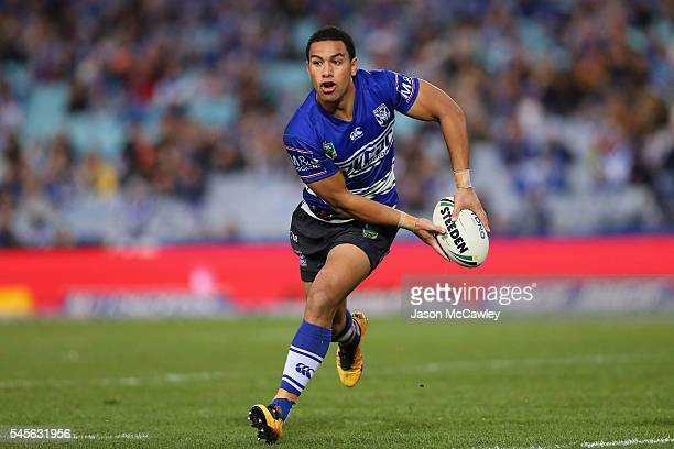 Will Hopoate of the Bulldogs runs with the ball during the round 18 NRL match between the Canterbury Bulldogs and the Wests Tigers at ANZ Stadium on...