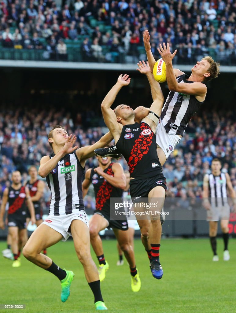 Will Hoskin Elliott competes for the ball over David Zaharakis of the Bombers during the round five AFL match between the Essendon Bombers and the Collingwood Magpies at Melbourne Cricket Ground on April 25, 2017 in Melbourne, Australia.