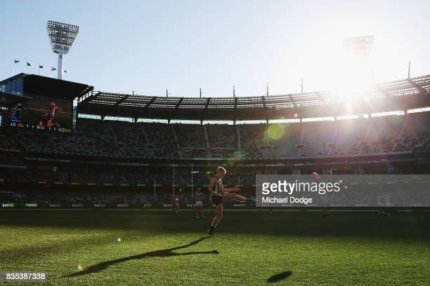 Will HoskinElliott kicks the ball during the round 22 AFL match between the Collingwood Magpies and the Geelong Cats at Melbourne Cricket Ground on...