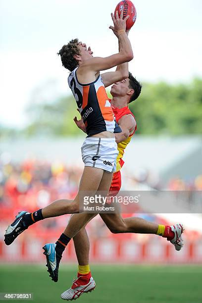 Will HoskinElliott of the Giants marks the ball over Jaeger O'Meara of the Suns during the round six AFL match between the Gold Coast Suns and the...
