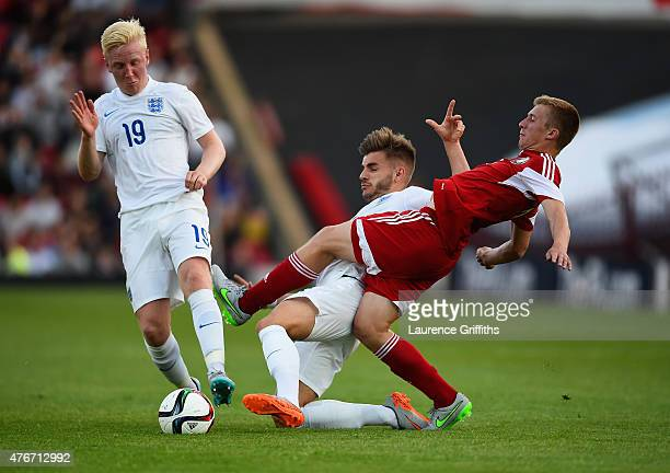 Will Hughes and Luke Garbutt of England battles with Yahuhen Yablonski of Belarus during the International Match between England U21 and Belarus U21...