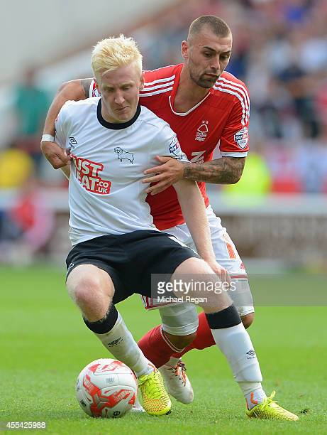 Will Hughes of Derby battles Jack Hunt of Notts Forest during the Sky Bet Championship match between Nottingham Forest and Derby County at the City...
