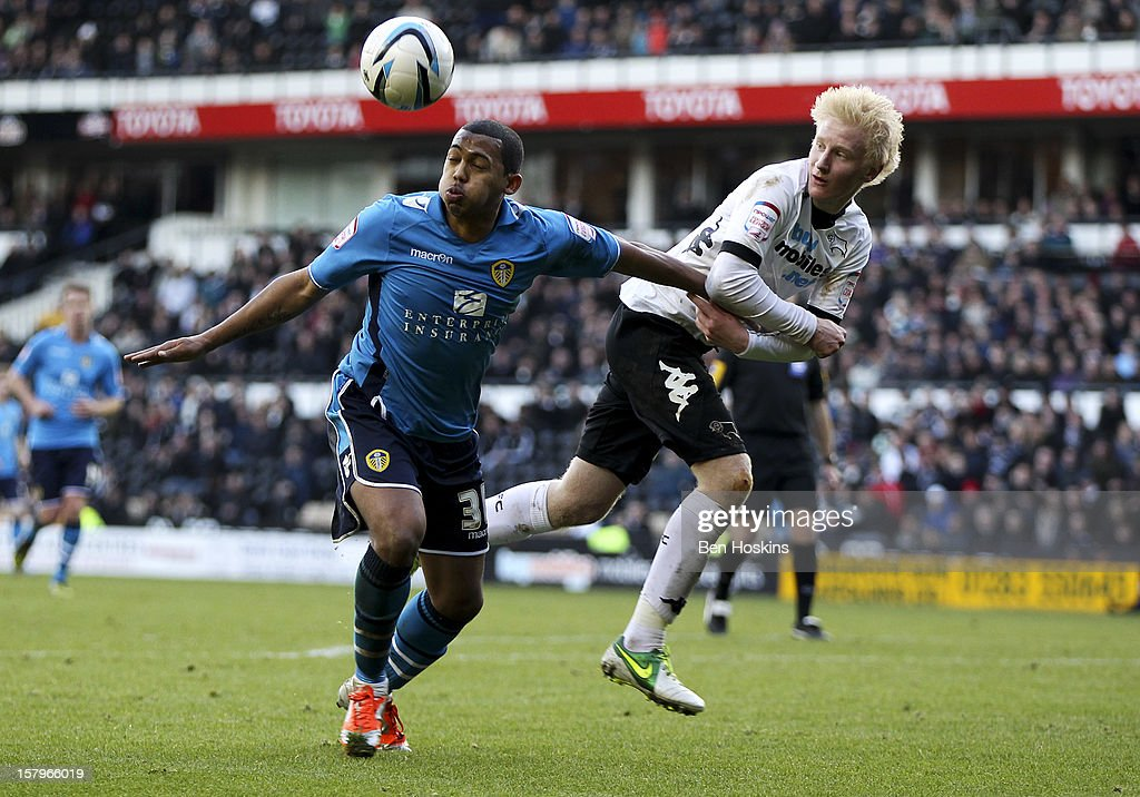 Will Hughes of Derby battles with <a gi-track='captionPersonalityLinkClicked' href=/galleries/search?phrase=Lee+Peltier&family=editorial&specificpeople=1007594 ng-click='$event.stopPropagation()'>Lee Peltier</a> of Leeds during the npower Championship match between Derby County and Leeds United at Pride Park on December 8, 2012 in Derby, England.