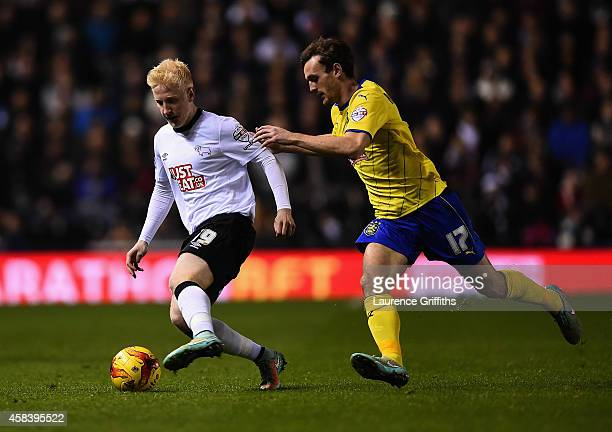 Will Hughes of Derby County battles with Jack Robinson of Huddersfield Town during the Sky Bet Championship match between Derby County and...