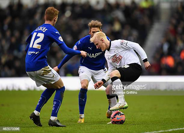 Will Hughes of Derby County battles with Sam Clucas and Daniel Jones of Chesterfield during the FA Cup Fourth Round match between Derby County and...