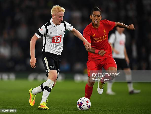 Will Hughes of Derby County is closed down by Roberto Firmino of Liverpool during the EFL Cup Third Round match between Derby County and Liverpool at...