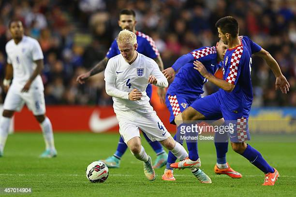 Will Hughes of England evades the challenge from Domagoj Pavicic of Croatia during the UEFA U21 Championship Playoff First Leg match between England...
