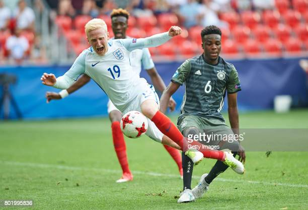 Will Hughes of England is challenged by Gideon Jung of Germany during the UEFA European Under21 Championship Semi Final match between England and...