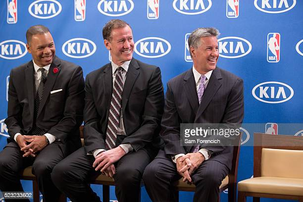 Will James Retail Marketing Manager Western Region of Kia Motors Head Coach Terry Stotts and General Manger Neil Olshey watch as CJ McCollum of the...
