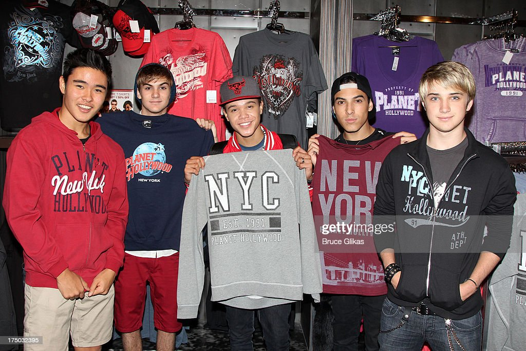 Will Jay Cole Pendery Dana Vaughns Gabe Morales and Dalton Rapattoni of the group IM5 visit Planet Hollywood Times Square on July 29 2013 in New York...