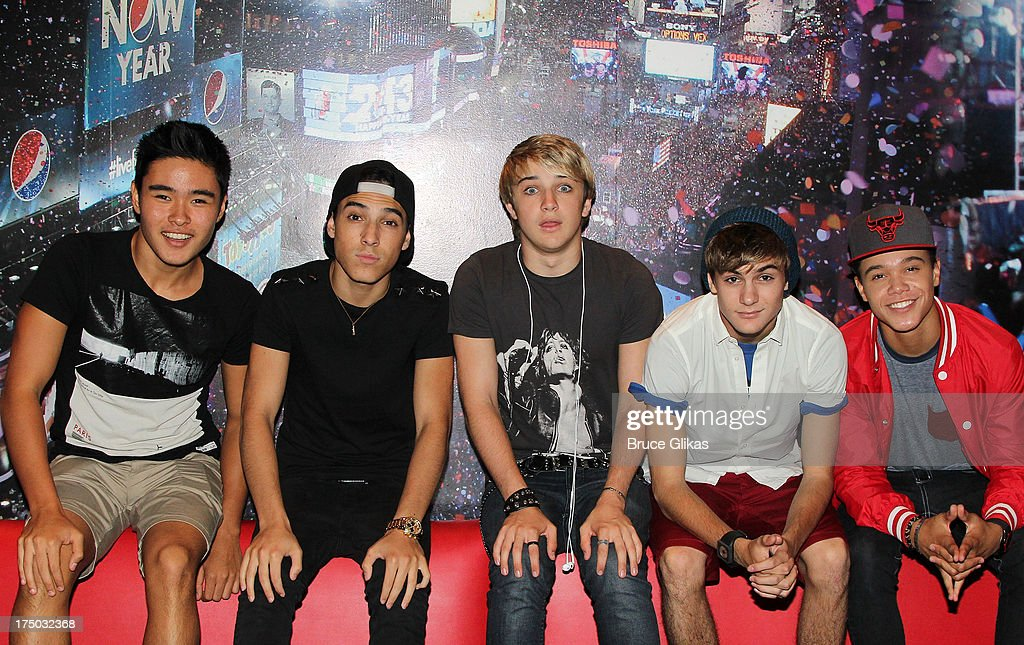 Will Jay Gabe Morales Dalton Rapattoni Cole Pendery and Dana Vaughns of the group IM5 visit Planet Hollywood Times Square on July 29 2013 in New York...