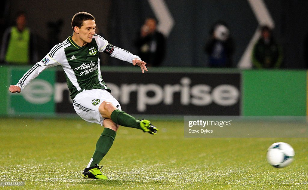 Will Johnson of Portland Timbers kicks a penalty kick to score during the first half of the game at JeldWen Field on November 7 2013 in Portland...
