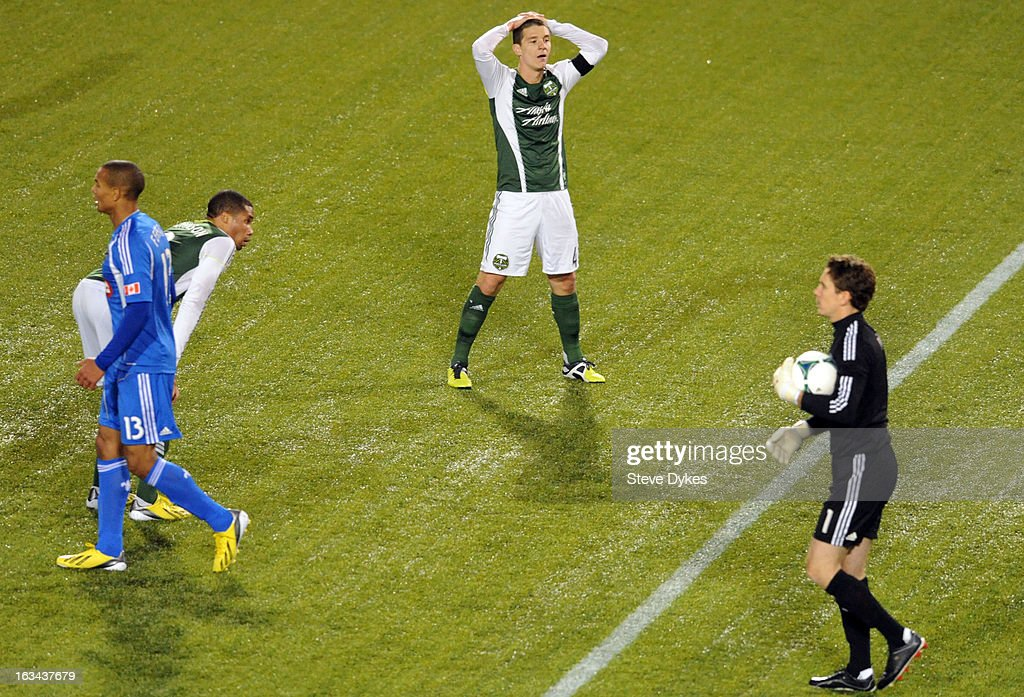 Will Johnson #4 of Portland Timbers puts his hands on his head as <a gi-track='captionPersonalityLinkClicked' href=/galleries/search?phrase=Troy+Perkins&family=editorial&specificpeople=596206 ng-click='$event.stopPropagation()'>Troy Perkins</a> #1 of Montreal Impact holds the ball as time winds down during the second half of the game at Jeld-Wen Field on March 09, 2013 in Portland, Oregon. Montreal won the game 2-1.