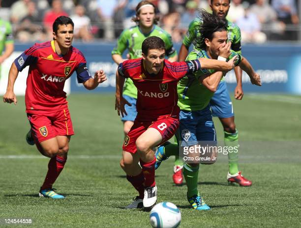Will Johnson of Real Salt Lake battles Mauro Rosales of the Seattle Sounders FC at CenturyLink Field on September 10 2011 in Seattle Washington Real...