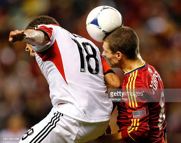 Will Johnson of Real Salt Lake heads the ball over Nick DeLeon of DC United during the second half of an MLS soccer game September 1 2012 at Rio...