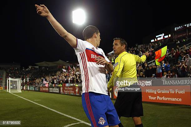 Will Johnson of Toronto FC questions the possession call by referee's assistant Kermit Quisenberry as the call favors the Colorado Rapids at Dick's...