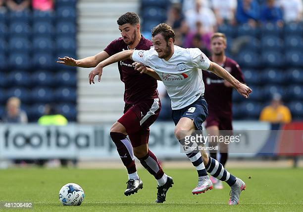 Will Keane of Preston North End in action with Callum Paterson of Hearts during the pre season friendly match between Preston North End and Hearts at...