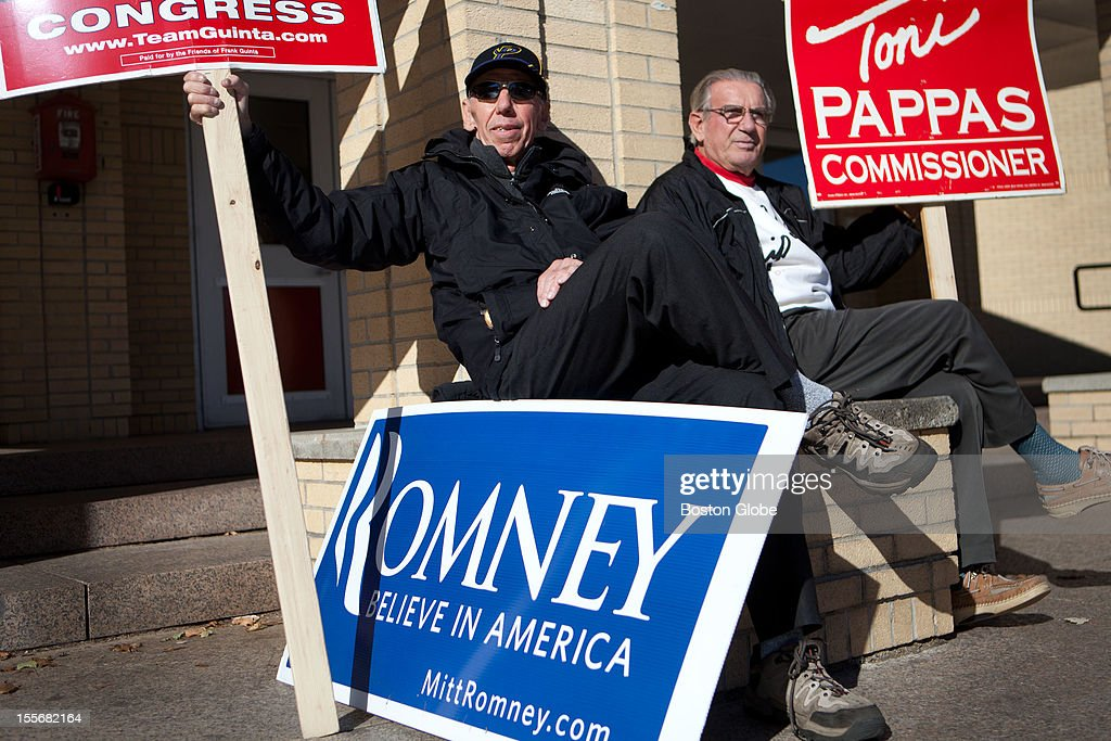 Will Kenerly, left, and Nicholas Vovlis sit outside of the voting location at Memorial High School in Manchester, New Hampshire, holding signs for candidates they support on Election Day, November 6, 2012.