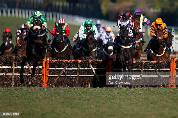 Will Kennedy riding Ebony Express clear the last to win The William Hill Imperial Cup Handicap Hurdle Race at Sandown racecourse on March 07 2015 in...