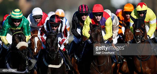 Will Kennedy riding Ebony Express on their way to winning The William Hill Imperial Cup Handicap Hurdle Race at Sandown racecourse on March 07 2015...