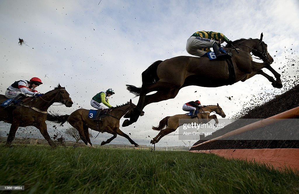 Will Kennedy riding Made In Time (green/yellow) on their way to winning The tauntonracecourse.co.uk Novices' Limited Handicap Steeple Chase at Taunton racecourse on January 09, 2012 in Taunton, England.