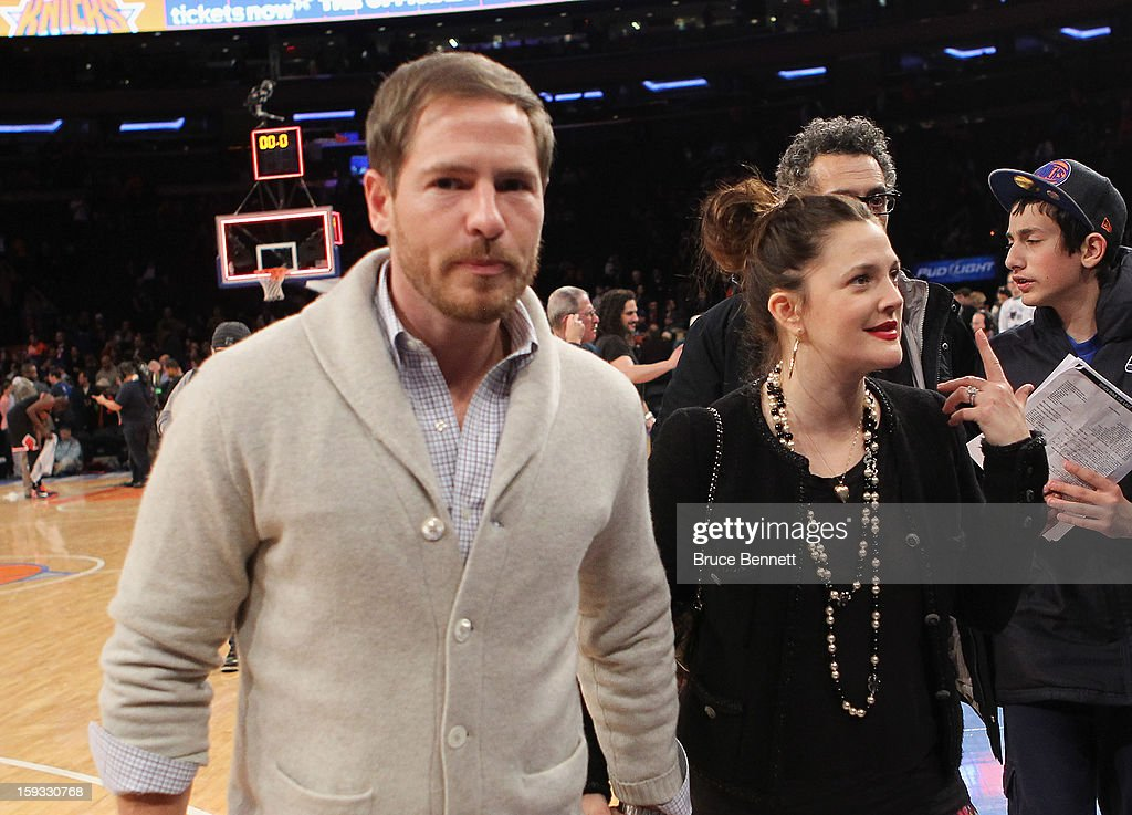Will Kopelman and wife Drew Barrymore leave the court following the New York Knicks 108-101 loss to the Chicago Bulls at Madison Square Garden on January 11, 2013 in New York City.