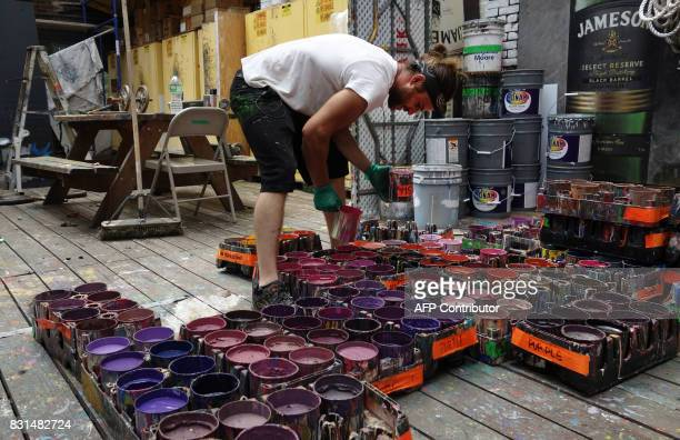 Will Krieg an apprentice for Colossal Media organizes paints at Colossal Media's office building August 2 in New York Colossal Media specializes in...