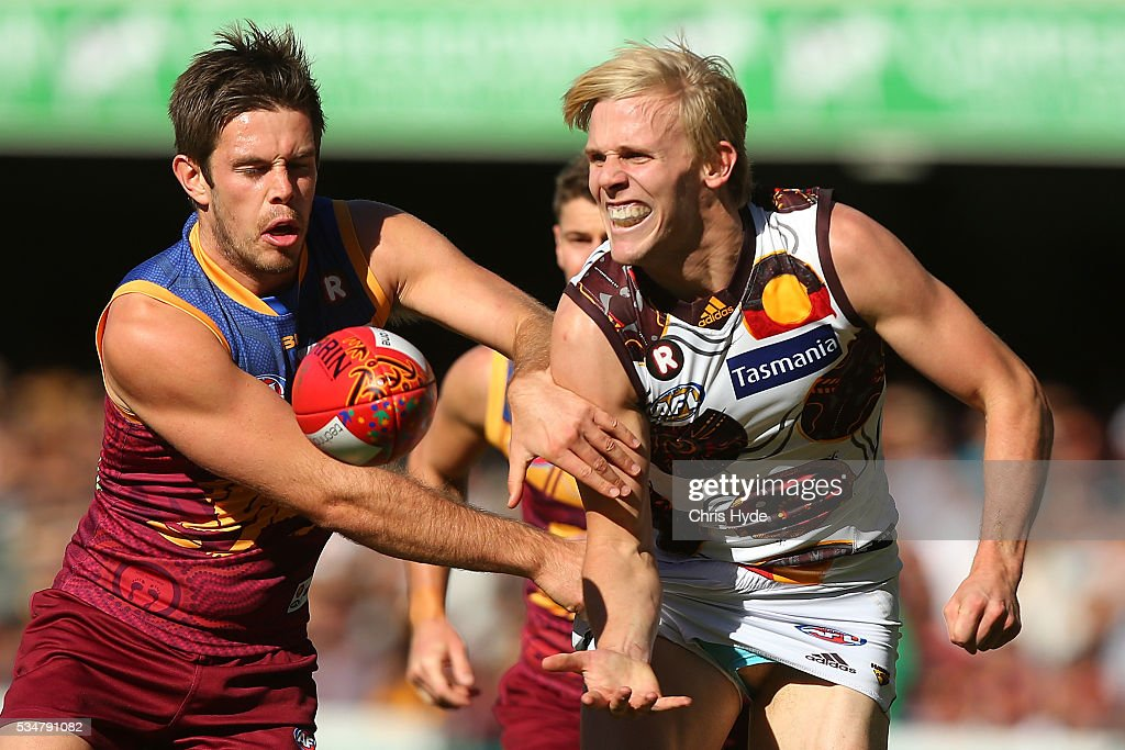 Will Langford of the Hawks handballs during the round 10 AFL match between the Brisbane Lions and the Hawthorn Hawks at The Gabba on May 28, 2016 in Brisbane, Australia.