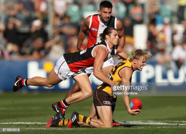 Will Langford of the Hawks is challenged by Jack Steele of the Saints during the round six AFL match between the Hawthorn Hawks and the St Kilda...