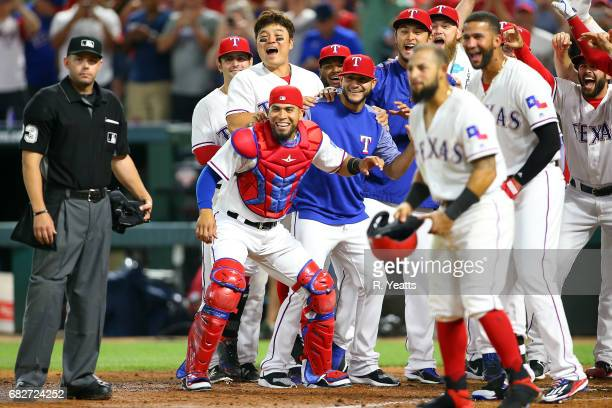 Will Little umpire looks on as Robinson Chirinos of the Texas Rangers Martin PerezShinSoo Choo and Yu Darvish celebrate as Mike Napoli not pictured...