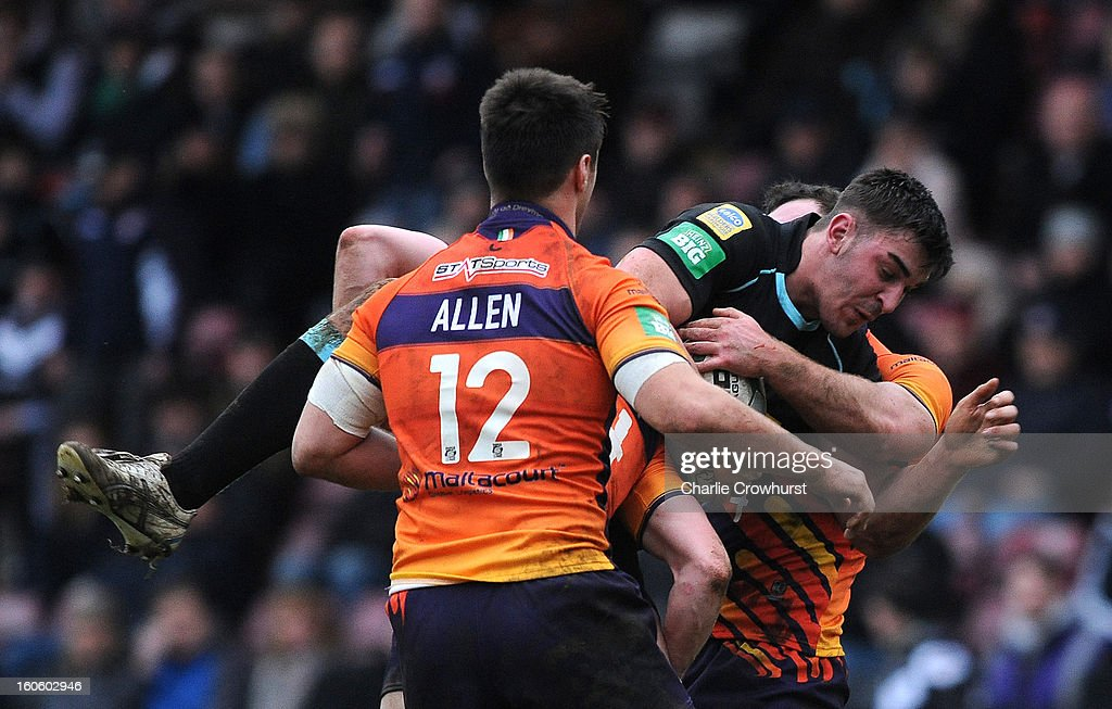 Will Lovell of London Broncos is held in the tackle during the Super League match between London Broncos and Widnes Vikings at the Twickenham Stoop on February 3, 2013 in London, England.