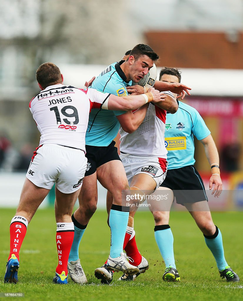 Will Lovell of London Broncos is tackled by Josh Jones of St Helens during the Super League match between London Broncos and St Helens at Twickenham Stoop on April 27, 2013 in London, England.