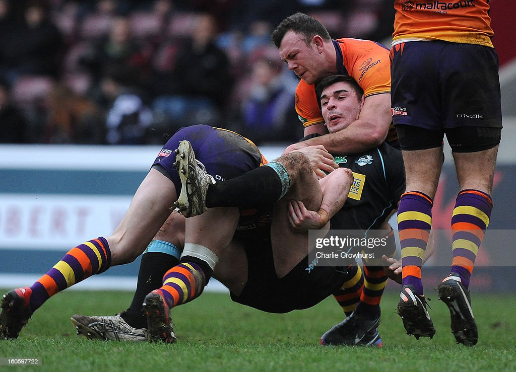 Will Lovell of London Broncos is tackled during the Super League match between London Broncos and Widnes Vikings at the Twickenham Stoop on February 3, 2013 in London, England.